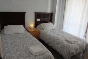 Cama o camas de una habitación en Decada Belindas Playa 11