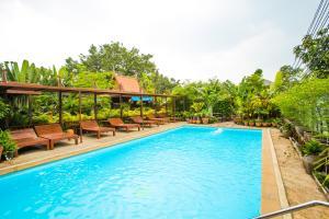 The swimming pool at or near Baan Tebpitak Elegant Ayotthaya