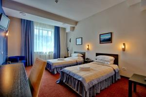 Кровать или кровати в номере Barcelona Spa-Hotel