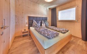 Ein Bett oder Betten in einem Zimmer der Unterkunft Marinelli Naturholz Apartement Suite
