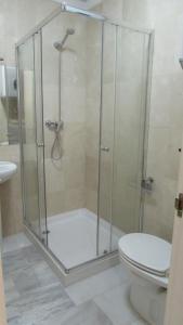 Ett badrum på Home4Holidays