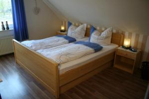 Ein Bett oder Betten in einem Zimmer der Unterkunft Landgasthaus Fecht
