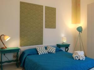 Letto o letti in una camera di Le Luminarie - Creative Residence