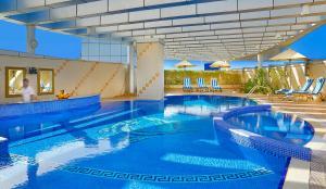 The swimming pool at or near City Seasons Hotel Dubai