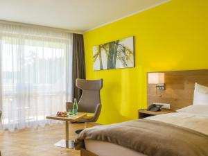A bed or beds in a room at 4* Superior Gesundheits-Resort, Hotel & SPA - DAS SIEBEN