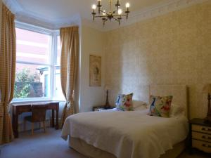 A bed or beds in a room at Inglewood Boutique Rooms With Self Catering