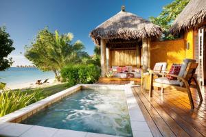 The swimming pool at or close to Likuliku Lagoon Resort - Adults Only