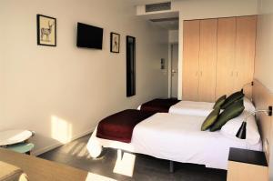 Een bed of bedden in een kamer bij Centre Esplai Albergue