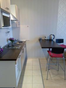 Кухня или мини-кухня в Red avenue