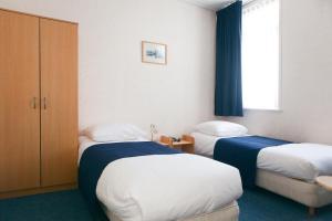 Кровать или кровати в номере HCR De Tukker
