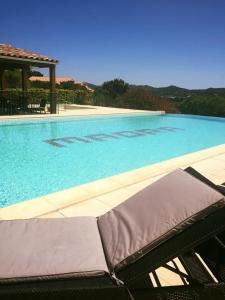 The swimming pool at or near Hôtel Maora Village