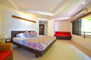 A bed or beds in a room at Punta Rosa Boutique Hotel