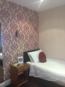 A bed or beds in a room at Best Western Bolholt Country Park Hotel