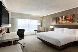 A bed or beds in a room at Delta Hotels by Marriott Saint John
