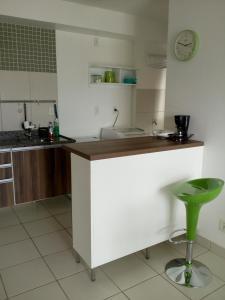 Una cocina o zona de cocina en Ajuricaba Suítes 5