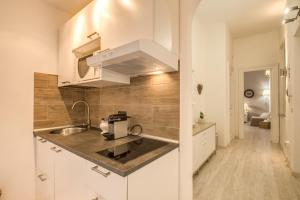 A kitchen or kitchenette at Vatican Miracle Suite