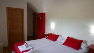 Cama o camas de una habitación en La Posada de Grimaldo