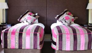 A bed or beds in a room at Airth Castle Hotel