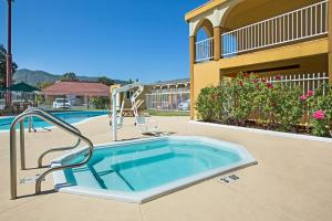 The swimming pool at or near Super 8 by Wyndham Ukiah