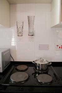 A kitchen or kitchenette at Nicopolis Self-Catering Apartments