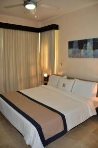 A bed or beds in a room at Watermark Luxury Oceanfront Residences
