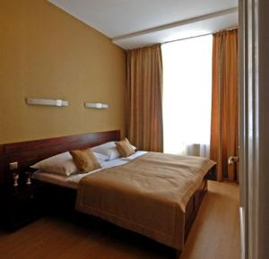 Кровать или кровати в номере U Stare Pani - At the Old Lady Hotel