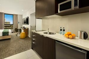 A kitchen or kitchenette at Quest Dandenong Central