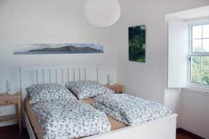 Cama ou camas em um quarto em Casa Emilia