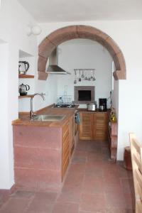 A cozinha ou cozinha compacta de Casa Emilia