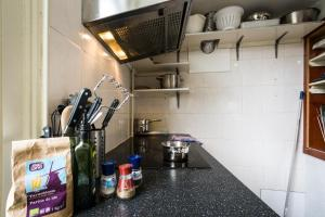 A kitchen or kitchenette at Stone Hotel & Hostel