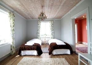 Säng eller sängar i ett rum på Uljebergs Bed & Breakfast