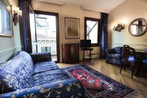 Гостиная зона в Suites Torre Dell'Orologio