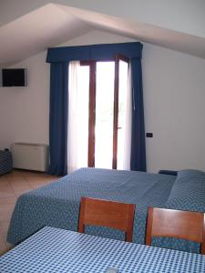 A bed or beds in a room at Resort Isola Rossa