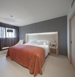 Cama o camas de una habitación en Sercotel Hola Tafalla