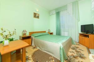 Кровать или кровати в номере Гостевой Дом Капитан С