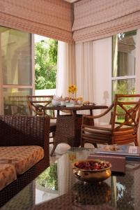 Een restaurant of ander eetgelegenheid bij Al Nahda Resort & Spa