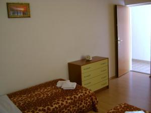 Ein Bett oder Betten in einem Zimmer der Unterkunft Apartments Mila