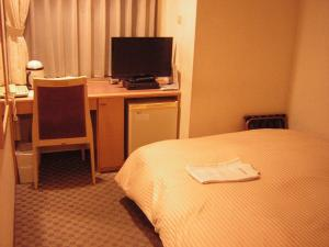 A television and/or entertainment center at Sapporo Classe Hotel