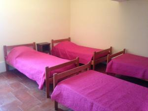 A bed or beds in a room at Appartement Guy