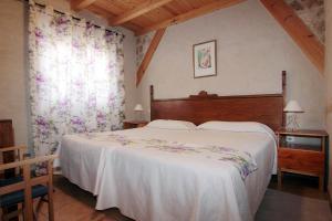 Cama o camas de una habitación en Apartamentos Turísticos los Abuelos
