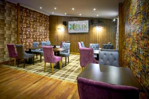 A restaurant or other place to eat at Helix Hotel