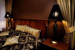 En eller flere senge i et værelse på Hotel Tønderhus