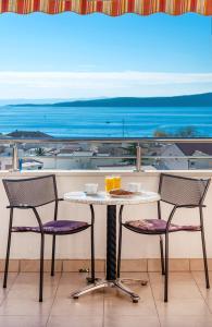 A balcony or terrace at Apartments Vila Adrijana & Fitness Studio WOLF