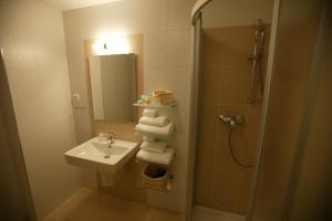 A bathroom at Aston Hotel