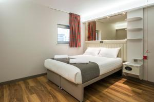 A bed or beds in a room at Point A Hotel Glasgow