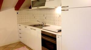 A kitchen or kitchenette at Green Village Accommodations