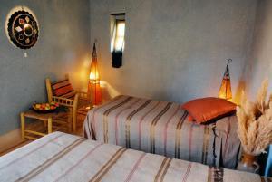 Ein Bett oder Betten in einem Zimmer der Unterkunft Riad Cascades d'Ouzoud