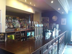 The lounge or bar area at Thomas Arms Hotel