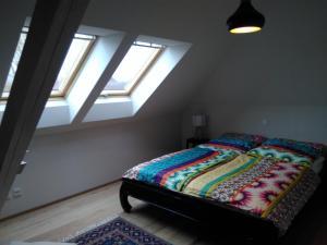 Ein Bett oder Betten in einem Zimmer der Unterkunft Boardinghouse Neumarkt Alte Schule