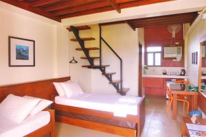 A bed or beds in a room at Agos Boracay Rooms + Beds